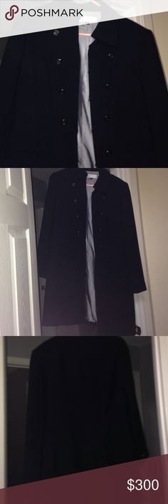 Tahari coat Black coat with silver buttons as accents. Very flattering. Barely worn. Military style. Great condition!! Tahari Jackets & Coats Trench Coats