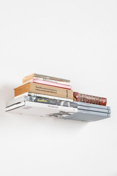 Invisible Double Book Shelf - such a neat idea and fun way to store and show off books