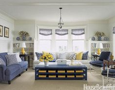Living room with yellow accents. Design: Tom Stringer. Photo: Ngoc Minh Ngo. housebeautiful.com #livingroom #yellow #blueandwhite