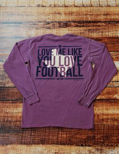 Have you ever thought... MAN! I wish you loved me like you love Football? Ya, we all have! Fall Means Football so show your love for football in this awesome Comfort Colors pocket long-sleeve t-shirt!