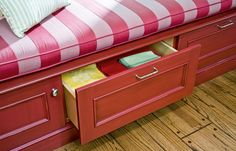 """These provide easy access without removing a seat cushion. Some cabinet companies sell what's called a """"pedestal drawer"""" with a built-in toekick that simplifies construction."""