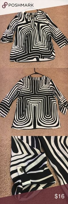 Cute black and white funky patterned blouse This blouse is made with a nice soft light feeling material. It's super cute and has a fun 70s vibe. Would be awesome paired with some dark wash super skinny jeans Roz & Ali Tops Blouses