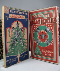 """Silverfoil & Doubl-Glo LEAD TINSEL Icicles * vtg 1930's Christmas Tree Ornaments ~ FIREPROOF CHRISTMAS ICICLES   This auction is for two packages of lead icicles. The Double-Glo box has a patent number of 1,957,256 which  was issued in 1934. The boxes measure 10"""" long. Icicles have been previously displayed and there are shorter sections included. Both boxes (package and contents) weigh a combined total of 4.8 ounces. Please note cardboard inserts are not original. Nice graphics on the…"""