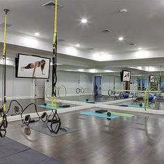 Basement Gym with Mirrored Walls and Wood Floors