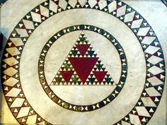 """Francesco De Comité took this photograph in the Church Santa Maria in Trastevere, Rome, Italy. He wrote in an email, """" The mosaics in this church are for the 12th-13th century. Seems like Sierpinski triangle has a quite long history!"""""""
