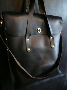 """FLUX sleek and compact, comes with a 9""""x6"""" interior pocket, removable shoulder strap. the body is constructed out of one piece of leather for maximum durability and a clean look. 15""""x14""""x4"""""""