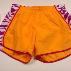Nike Dri-fit Orange and Purple Tempo Shorts Nike Dri-fit Patterned Oranged, Purple and White Tempo Shorts Size includes purple drawstrings on the inside  Small Worn only Once Silver Nike swoosh in perfect condition Nike Shorts