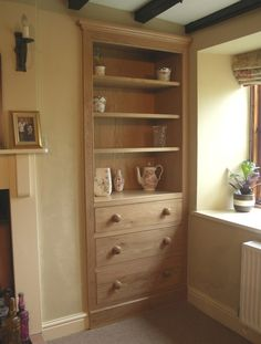 English cottages have always got chimney alcoves that make really good storage options. Tel: 01773 550387 with price enquiries. Cottage Interiors, Dollhouse Interiors, Alcove Cupboards, Fitted Cabinets, Dream Bathrooms, Family Room, Bookcase, Furniture Design, New Homes