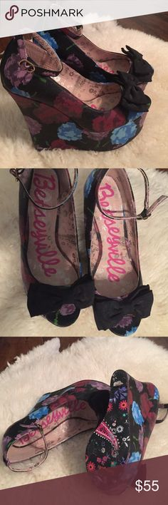 Adorable Betsey Johnson wedges.  Size 7. Betseyville floral wedge shoe.  Peep toe with an ankle strap.  Excellent condition except for a smudge on the back of one. (Last picture reflects). The flaw is barely noticeable.  I didn't even know it was there until I looked carefully.  It certainly isn't noticeable while wearing!  Pretty and fun!😊 Betsey Johnson Shoes Wedges