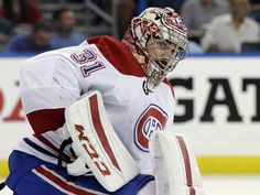 Montreal Canadiens goalie Carey Price (31) looks on after Tampa Bay Lightning center Steven Stamkos (91) scored a goal during the second period of Game 6 of a second-round NHL Stanley Cup hockey playoff series Tuesday, May 12, 2015, in Tampa, Fla.