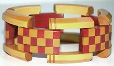 bakelite boutique....bracelet in yellow and orange checkerboard pattern.
