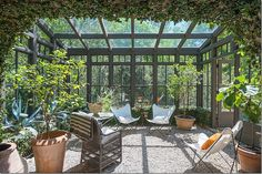 home of former owner of Ballard Designs...black sunporch/greenhouse