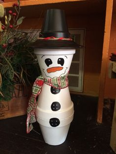 Country snowman made from clay pots.