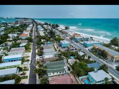 Enjoy a relaxed Island getaway with costal charm in this cheery two-bedroom, two-bath elevated Duplex just a block from the beach! As you enter the front doo. Bradenton Beach, Anna Maria Island, Beach Picnic, Snack Bar, Back Patio, Simple Living, Oasis, Tub, Whimsical