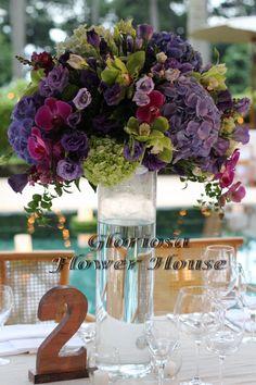 Purple hydrangea, purple lisianthus, purple snapdragons, accent of green hydrangea, green billy balls, purple phalaenopsis orchids and green cymbidium orchids.
