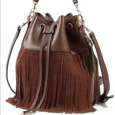 Bucket Fringe mini handbag Bran new bucket fringe leather handmade  handbag. Very cute perfect gift for the holidays🎉no trade. Look the same as picture. Crossbody bags. Able to hold quite a few things like a wallet, makeup, cell phone, a light scarf, Ipad mini.📦Next day shipping Bags Mini Bags