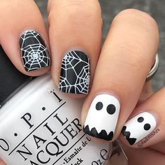 I love these insanely cute and oh-so-easy ghost nails! I was inspired by many Pinterest photos. Plate is @uberchicbeauty Halloween-02 and I used @opi_products Alpine Snow and @sinfulcolors_official Black on Black! Another Halloween mani for #clairestelle8halloween  Totally digging the black and white combo!
