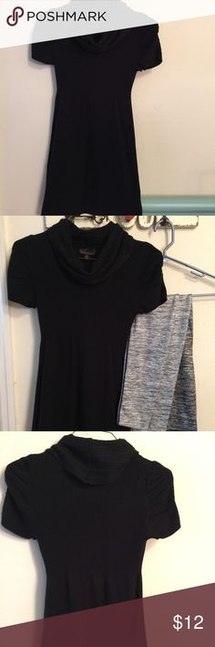 Black sweater dress Black sweater dress with loose turtleneck style neck, and is a size medium in good condition! Tops Tunics