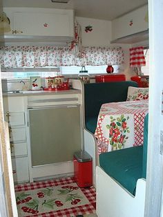 OK, technically this is a camper, but I love the large ginham with the cherry fabric.  Would make cute 'vintage' looking curtains in the kitchen!