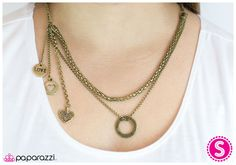 Pulling at My Heartstrings - brass (silver in stock) http://paparazziaccessories.com/29621
