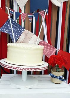 Simple cake with bunting at a Memorial Day Party Ideas!  See more party ideas at CatchMyParty.com!