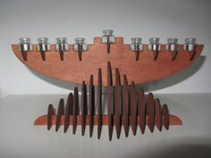This listing is for a wooden 3 dimentional menorah (Hannuka Menorah) .  The entire menorah is stained with a maple wood stain. It has been