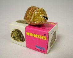 Wade Whimsies and Figurines. I can remember buying these at Manor House Park Tenby and Penscynnor Wildlife Park Neath.