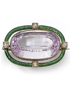 An early 20th century light violet/pink topaz and enamel brooch. The brooch in Suffragette colours, collet-set with an oval-cut pink topaz, in an openwork green guilloché enamel frame, accented at the cardinal points by cushion-shaped diamonds, width 3.0cm. #Suffragette #antique #brooch