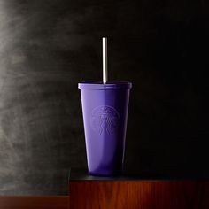 An insulated stainless steel Cold Cup tumbler with a stainless steel straw and purple exterior.