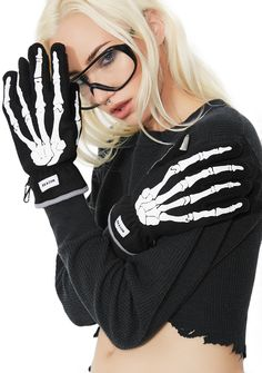 Reason Bones Gloves got ya feelin' creepy. These black gloves have white bone graphics on top, a white panel on the palm, and touch screen friendly fingertips.