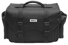 Nikon Digital SLR Camera Case Gadget Bag by Nikon. $29.95. Protect your valuable camera investment with this Nikon brand camera carrying case. Made from durable nylon, and outfitted with a slip-resistant handle that is attached with stitching and rivets for extra safety, this compartment case will easily hold your camera with attached zoom lens and battery grip, lenses, flash, and accessories.  Travel is made even easier and more comfortable with the padded shoulder str...