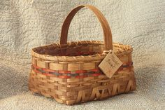 This Medium Market Basket is handcrafted by Virginia artisan Mildred Daniel. The basket is constructed of quality reed, and the handle is