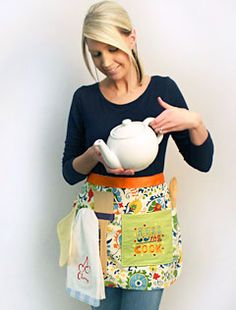 """Free project instructions for making this apron with embroidery by Embroidery Library saying """"Kiss the Cook"""" or pick a different design that appeals to you more."""