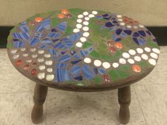 Adorable mosaic stool handcrafted by adults with intellectual and developmental disabilities.