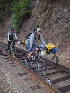 "Rail bikes, loaded by huntercycles. The ""sidecar"" folds back into a sort of 3rd wheel trailer when off the tracks.:"