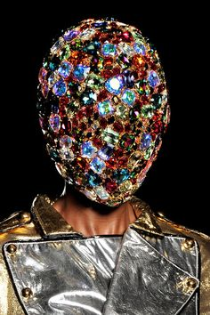 Philip Treacy created a colorful helmet style hat using hundreds of Swarovski crystals