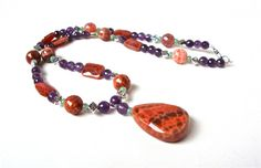 Purple and orange gemstone statement by sparklecityjewelry on Etsy, $40.00