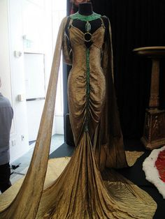 """Debbie Reynolds Auction - Claudette Colbert gold-lame and emerald royal boudoir gown from """"Cleopatra"""" (1934) by Kevin Cline, courtesy of PopCultureGeek"""
