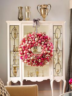 Make the Most of Furniture No wall space for a wreath? No problem. Hang an ornament-filled beauty from a display case, a side table, your mantel, or even interior windows for a quick pop of Christmas.