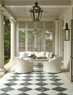 suzanne-kasler-milieu-la-dolce-vita-veranda / Great floor. Fab shutters & lanterns.