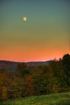 Moonrise over Bethel, Maine. Photo by Memahat via Wunderphoto