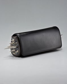 Spiked Marquise Clutch  by Christian Louboutin at Bergdorf Goodman.