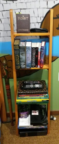 Repurposed Bunk Bed Ladder * Removed the hooks that would connect it to the top bunk and...Voila! A cool new book shelf for my tweenage son *