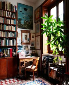 An Art Nouveau desk is tucked into a corner of the library.: