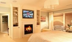 Like the built-ins with fireplace and TV for master bedroom.