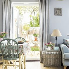 Blue-grey living room diner with French windows