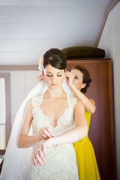 lovely lace wedding dress (and the bmaid's bright yellow dress is adorable)
