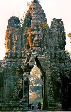 The gate of Angkor Thom, Cambodia #Travel #Places #Photography