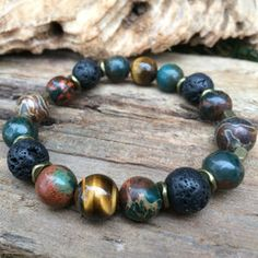 Jasper, Tiger's Eye and Lava for grounding and balance. Add your favorite essential oil to the lava stone and it'll diffuse for up to 3 days.   Be The Change | LavHa