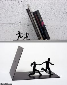 """Falling Bookends"" by Art Ori.  Available with two figures running away from falling books, or one figure with hands raised in a defensive posture."